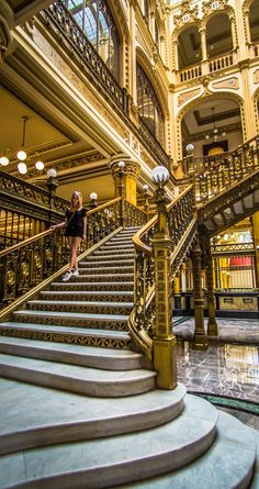 Roaming the golden staircases in Zocalo's Postal Office, Mexico City.