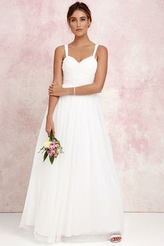 We'll make dress shopping as easy as we can for you with the Sunday Kind of Love Ivory Tulle Gown! You won't believe how gorgeous this maxi dress is in real life, with layers of tulle wrapping a padded sweetheart bodice (with shoulder straps), and expanding into a voluminous full skirt. Wear it as-is, or customize to your heart's desire! Hidden back zipper/clasp.
