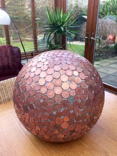 Got this idea off Pinterest for my Dad. He had a load of coppers that he didn't know what to do with so I made this beautiful penny ball for his garden. Can't wait for the coppers to go green.