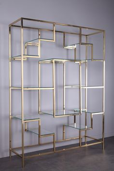 Large brass bookcase by Kim MOLTZER from the It has a beautiful sculptural geometric form, finished in brass, which support 12 glass display shelves and a further central display niche that adds a strong central focal point. Interior Decorating, Floating Glass Shelves, Glass Shelves Kitchen, Glass Furniture, Glass Bookcase, Glass Shelves In Bathroom, Wine Glass Shelf, Glass Shelves Decor, Glass Display Shelves