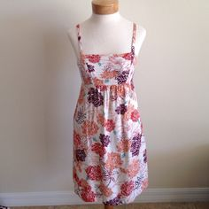Tommy Bahama Dress Tommy Bahama dress that is super cute with adjustable straps. There is one flaw as shown in the last picture from tag being removed. I sewed it, no biggie. Other than that, it's in great condition!!! Price reflects flaw. Tommy Bahama Dresses