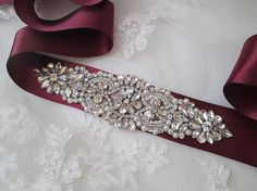 Marsala Bridal Satin Sash with Bling, Crystals, Rhinestones www.etsy.com/shop/GibsonGirlGarters Soft, luxurious satin bridal sash embellished with the highest quality crystals, pearls and rhinestones. Bridal applique measures 6 (15.24 cm) X 2 (5.08 cm) Ribbon Sash measures 3