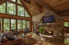 Living Area Features Stone Double-sided Gas Fireplace and Large, Flatscreen HDTV