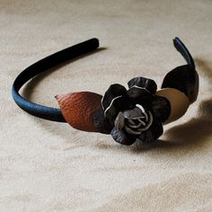 Skinny little headband decorated with leather flower. This headband does not pinch...it is comfortable to wear all day. These handcrafted headbands are fun and pretty. FREE SHIPPING