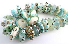 http://www.ebay.com/itm/PT-Lampwork-Handmade-Glass-Beads-Turquoise-Sage-Ivory-Disks-SRA-/190799959307?pt=LH_DefaultDomain_0=item2c6c90550b