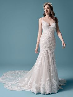 No surprise that nature-inspired motifs have been, are, and will remain a big deal in bridalwear. But this floral lace mermaid wedding gown can be considered an enchanted garden unto itself. Sequined lace motifs over tulle Deep illusion V-neckline Deep scoop back neckline Beaded spaghetti straps Covered button over zipper closure Extended scalloped lace train
