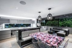 Ready for something unique? This contemporary open space gets a pop of color with a Concetto backlit dining table. Another design gem using semi-precious stones by Kim Duffin Design.