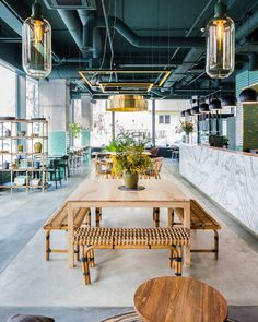 Inside a jungle-inspired restaurant in Bucharest, designed by local architect Bogdan Ciocodeica who created the interiors of the stunning eatery.