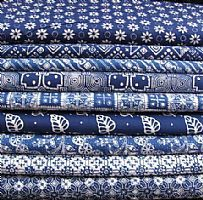 Blue and white batik: This hand stamped batik fabric comes from Java, where the very best batik in the world is produced. It is made at a small family workshop in the town of Jogyakarta where batik has been made for many generations.