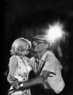 Eve Arnold: US actress Marilyn Monroe with Arthur Miller showing her some dance steps for a scene she has to play. Nevada, 1960