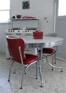 My parents had the chrome-rimmed Formica table and shiny red plastic chairs with chrome legs. I loved that dining set.