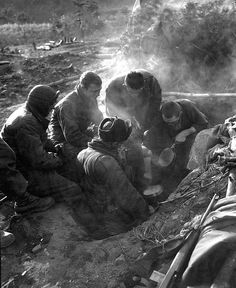 Korean War - HD-SN-99-03131 by Morning Calm News, via Flickr These men of the Heavy Mortar Co., 7th Inf. Regt., go native, cooking rice in their foxhole in the Kagae-dong area, Korea. December 7, 1950. Pfc. Donald Dunbar. (Army) NARA FILE # 111-SC-354103 WAR & CONFLICT BOOK #: 1472