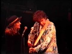 """Times They Are A Changin'-Bob Dylan & Liz Souissi.. Fan surprises Bob by going on stage to sing with him. The body guard tries to remove her but Bob said """"No let her stay"""" and they sing together beautifully. She goes to leave after the song is finished but returns to give Bob a kiss."""