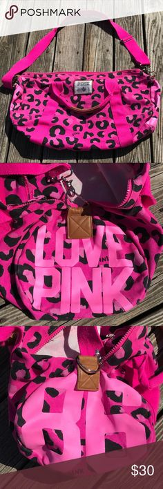 """VS PINK LARGE DUFFLE BAG Large VS PINK duffle bag in hot pink and magenta leopard print. Large travel bag that holds a TON! Only a few small signs of wear on the ends as pictured in 2nd and 3rd photo. Zip closure on top and adjustable shoulder strap. Approximate dimensions are 25""""x10""""x15"""" PINK Victoria's Secret Bags Travel Bags"""