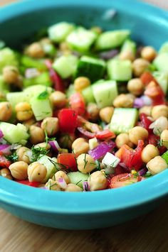 Cucumber and Chickpea Salad - olive oil, garbanzo beans, tomato, red onion, celery, cucumber, minced garlic, fresh dill, red wine vinegar, lemon, lime, black pepper, fresh parsley