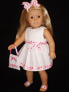 Pink polka dot dress, shoes, purse, and hair bow