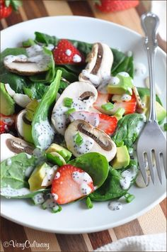 This spinach salad is topped with strawberries, mushrooms, avocado, almonds, and the best homemade creamy poppyseed dressing. Fresh, colorful, and ready in 15 minutes!