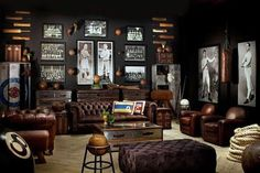 Restoration Hardware sports room/man cave with masculine elements. Brown leather chesterfield sofa, tufted leather ottoman, old world touches, and vintage prints and etchings. I really like the aluminum trunks and club chairs, but I'm not sold on the lo Man Cave Couch, Man Cave Room, Man Cave Diy, Man Cave Home Bar, Mens Man Cave Ideas, Man Cave Den Ideas, Man Cave Lounge Ideas, Vintage Man Cave Ideas, Cigar Lounge Man Cave