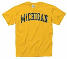 Michigan Wolverines Gold Arch T-Shirt by New Agenda. $12.99. 100% Cotton. For a roomier fit, please order one size up. Officially licensed. Lightweight rib knit t-shirt. Basic crew neck. Whether you are cheering your team on at the stadium or just strolling around campus make sure you are oozing with team spirit. Show your team pride than with this Michigan Wolverines Gold Arch T-Shirt! This comfy shirt features screen print graphics of team logo and wordmark,...