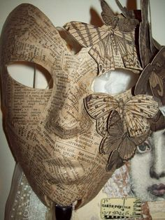I've always liked the look of newspaper masks, and the three-D moths make this stand out for me. (Paper Mask w moths)