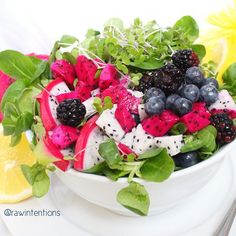 Mâche greens, red and white dragon fruit, blueberries, blackberries, hemp hearts, kale micro greens, and lemon