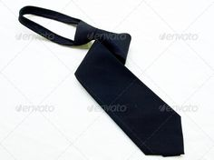 A rolled up black tie isolated on white background. ...  Rolled Up, background, black, blue, business, choker, clean, clothes, clothing, collar, color, colored, cravat, fashion, garments, isolated, male, men, necktie, pattern, pressed, set, shirt, silk