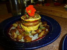 local vegetable and quina stuffed squash, tomato and local cheese tart and  scrambled local egg and home fries