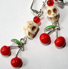Howlite stone skulls, enameled cherries, and Silver plated lever back hooks. Unique!  They drop 2 (5.1cm) from top of ear wires.  Gift pouch included.    Visit my Shop: https://www.etsy.com/shop/Exgalabur    Thank you