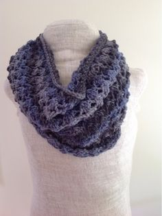 This beautiful yarn has subtle color changes and a slight shimmer, making a lovely, lacy cowl. I used two skeins of Red Heart Boutique Midn...