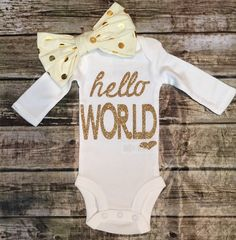 A personal favorite from my Etsy shop https://www.etsy.com/listing/247880217/baby-girl-onesie-hello-world-onesie-for