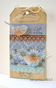 handmade card by Jacqueline: Life is a song ... adorable die cut birds distressed and stamped ... blue daisy pring paper ... shipping tag base ... sweet split sentiment ...  delightful card!!!