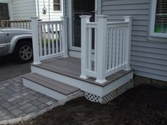 Front porch (Trex) with brick walkway