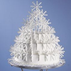 Shimmering Snowflake Tree Cake - A sculpture of dainty royal icing snowflakes adorns this stunning cake creation. Set atop the Scrollwork Cake Stand, this cake makes a fabulous centerpiece for any winter celebration!