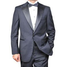 Dress your best in timeless, stylish fashion with this black, one-button tuxedo. This 100 percent wool tuxedo is fully lined and features four detail buttons on the cuff, a double side-vented back button, underarm sweat guards, and a notched lapel.