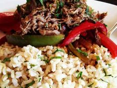 Steak Carnitas & Sautéed Peppers over Cilantro Lime Rice | Ingredients 2 lb flank steak 1 Tbsp salt 1 1/2 tsp pepper 1 1/2 tsp garlic powder 4 onions, divided 1 1/2 tsp liquid smoke 1 cup water 3 red bell peppers, sliced 2 green bell peppers, sliced 6 garlic cloves, sliced brown rice cooked per package directions (I made 2 family sized 10 minute []
