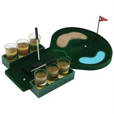 """Now $24.95 was $33.95 Line up your best shot- how you do determines who takes a drink in this tabletop game of golf. It's great for parties or casual get-togethers. Features miniature golf course measuring 9-3/4"""" x 12-5/8"""" x 1-7/8"""", 2 side shot caddies with game rules, 6 shot glasses, 2 golf clubs measuring 1-1/2"""" x 5-1/4"""" x 1/2"""", 2 metal balls, sand, and 19th hole flag. Gift boxed."""