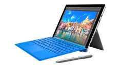 Microsoft Surface Pro 4 - 128GB / Intel Core i5: Right angled front view of device with blue type cover, Surface Pen and kickstand
