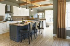 Shown on the kitchen walls is Pratt & Lambert Silver Mink 33-25