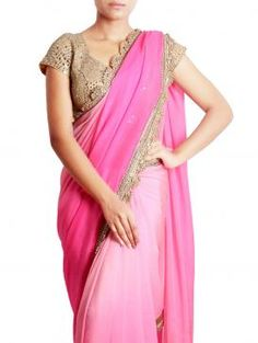 Elegant pretty Pink Georgette Saree  from the  Sayisha.The golden zari border on the baby-pink base is nicely complementing each other.