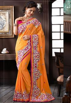 #Orange #Georgette #Saree With #Blouse  #Orange #Georgette #Saree designed with Heavy Zari,Resham Embroidery With Stone Work And Lace Border And Cut Work.  INR: 8,221.60 only  With #Amazing #Discounts  Grab At http://tinyurl.com/j5wc7h9