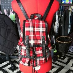 Cute Plaid Backpack Been used many times but the only damage isn't visible. Couple of holes by the button and the Inside lining. Offers accepted! Claire's Bags Backpacks
