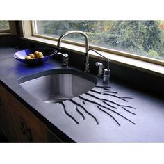 Concrete Countertop Design for Kitchen Countertop. Drainboard integrated
