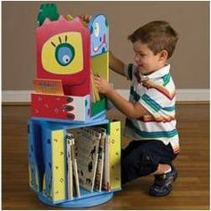 Add some fun and excitement to your son's room with this colorful Monster Double Revolving Bookcase. With the two shelves and 4 book racks, there is ample room for all of his reading material. There is even storage on the top for his favorite knickknacks.