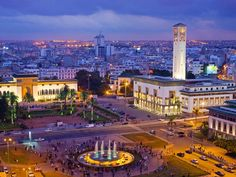 Photograph by Scott E. Barbour/Getty Images    Twilight falls on the Place Mohammed V in the heart of Casablanca. The vast square is fronted by administrative buildings—including the Palais de Justice law courts building, at left, and the Ancienne Prefecture (Old Police Station) at right.