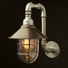 plumbing fittings wall light w/ cage. bronze shade.