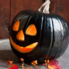 Paint your pumpkin this year before you carve it to make it extra spooky! (Halloween Pumpkins Lights)