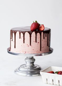 Chocolate-Dipped Strawberry Cake: Decadent Chocolate Cake with Strawberry Buttercream Frosting and Chocolate Ganache Drips