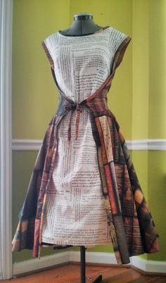1950s Librarian dress. The words fabric contains quotes from Neil Gaiman, Dorothy Sayers, Lois McMaster Bujold, Jasper Fforde, JRR Tolkein. The book spines fabric is a lovely design bypeacoquettedesigns on Spoonflower.