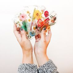 These phone cases are decorated with dried flowers.