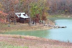 I rented this cabin a few years back.  Log cabin on a private lake.  Hot tub, claw foot bathtub, room to sleep 8.  Fully stocked kitchen.  In Elkland, MO.